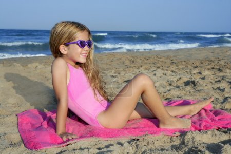 Trendy fashion little summer girl on beach