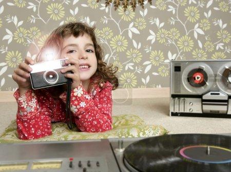 Camera retro photo little girl in vintage room