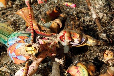 Fallas clown figure half burned after crema in Valencia