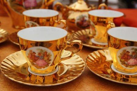 Ancient golden porcelain cups coffe or tea