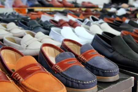 Photo for Leather shoes retail shop in rows varied colors arrangement - Royalty Free Image