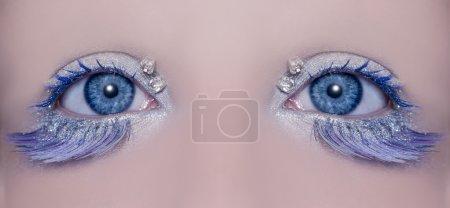 Blue eye macro closeup winter makeup jewels diamonds