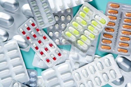 Blister medical pills background green desk
