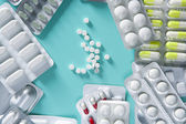 Blister medical pills background green desk