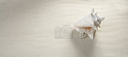 Photo for Beach sand pearl necklace shell like a summer vacation symbol - Royalty Free Image