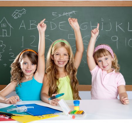Photo for Clever kids student group at school classroom raising hand as smart children - Royalty Free Image