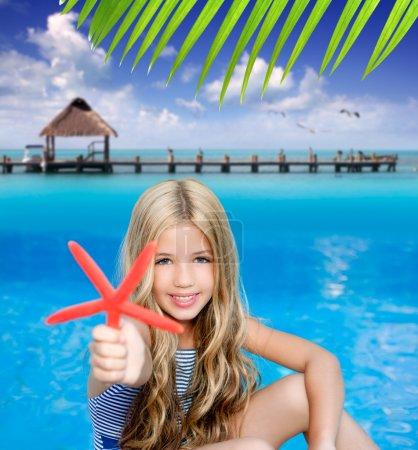 Children blond girl in summer vacation tropical beach