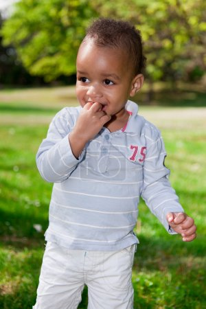 Portrait of baby boy playing in the park