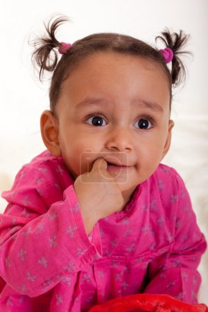 Beautiful african american baby girl with his finger in the mouth