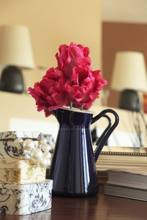Photo for Single flower arrangement in an iron pitcher with pearls - Royalty Free Image