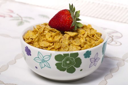 Bowl of cereals with strawberry
