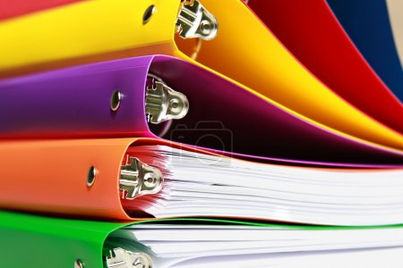Photo for Stack of colorful file folders with details of the filing clamp and pin - Royalty Free Image