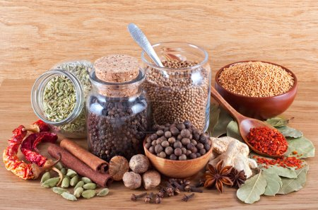 Still life of different spices on wooden backgroun...