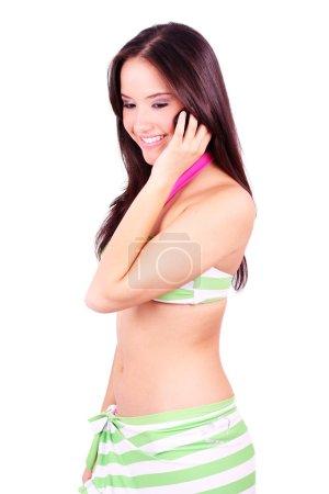Woman in bikini talking on the phone