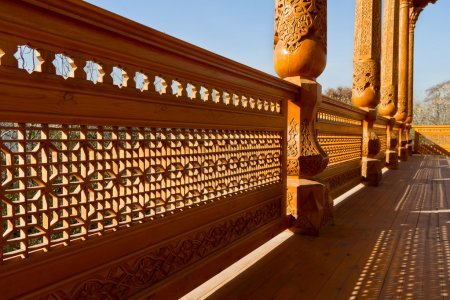 Carved wood rail and column in summer pavilion. Ta...