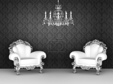 Luxurious armchairs in baroque interior. Ornament wallpapers.