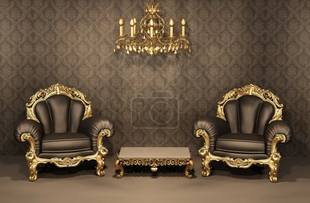 Armchairs with gold frame in old interior. Luxurious furniture.