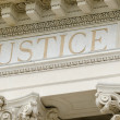 Justice word engraved on the pediment of the court...