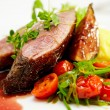Glazed duck fillet, mashed potatoes seasoned with ...