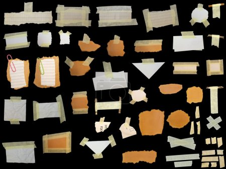 Set paper scraps,cardboard, newspaper and masking tape isolated on black