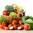 Composition with raw vegetables and wicker basket ...