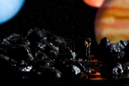 Abstract view of planets and a water drop