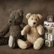 Teddy bears on brown background...