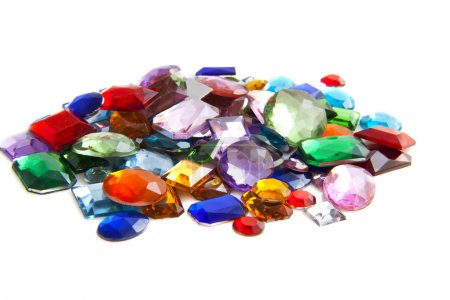 Colorful gem stones isolated on a white background...