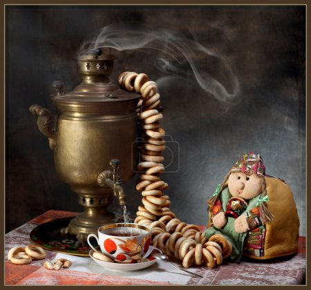 Traditional Russian tea drinking with a samovar on...