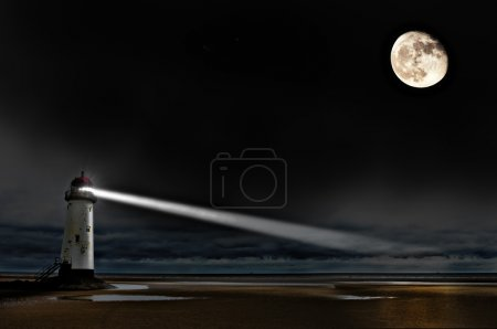 Photo for A lighthouse on the coast at night with beam of light and a big bright moon - Royalty Free Image