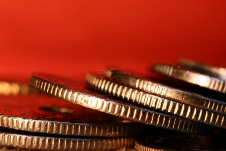 Piles of money coins closeup
