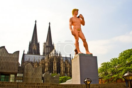 """Photo for """"Adam"""" from Michelangelo in Pink is standing in front of the cologne dome, germany, symbol for homosexuals - Royalty Free Image"""