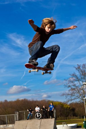 Boy is jumping with his skateboard