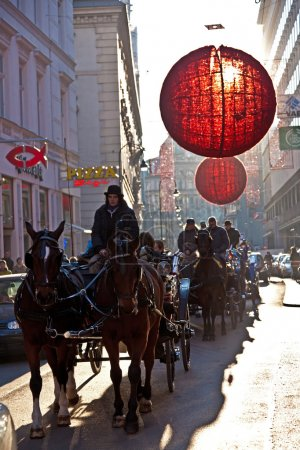 Streets are decorated with red christmas bauble ornaments