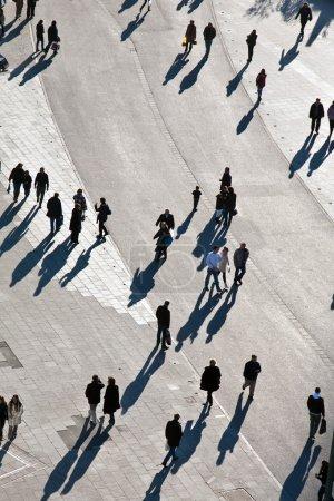 walking in a pedestrian area seen from birds view, lookin