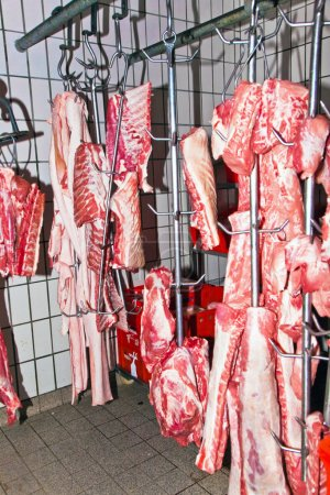Meat in a cold storage house of a butchers shop