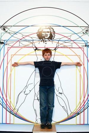 Boy imitates Leonardo da Vincis ideal man