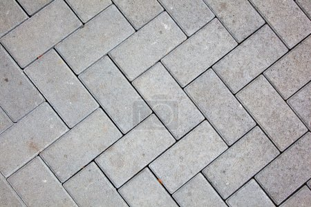 Pavement pattern made with cast concrete blocks in grey color