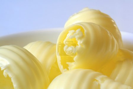 Butter curls in a small white butter dish....