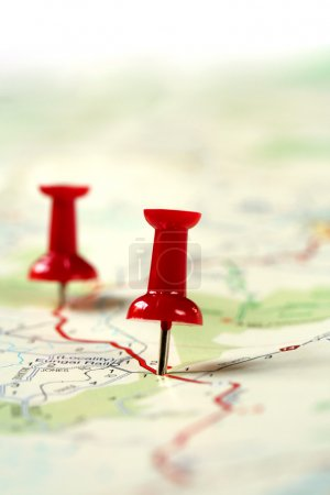 Photo for A map route marked with red push pins. Shallow depth of field. - Royalty Free Image