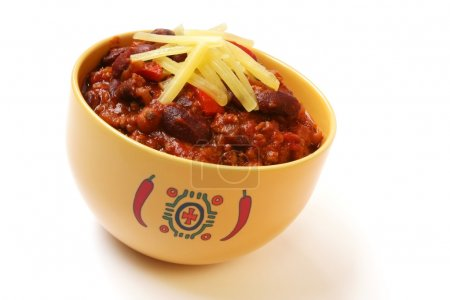 Photo for A bowl of home made chili, with beans and grated cheese. - Royalty Free Image