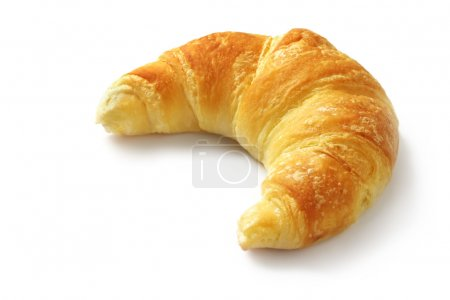 Photo for Single fresh croissant, casting soft whadow on white. Delicious! - Royalty Free Image