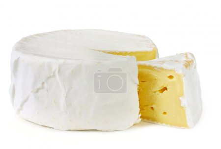 Photo for A wheel of rich creamy brie cheese, with a wedge cut out. Isolated on white. - Royalty Free Image