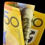 Folded Australian fifty dollar note, against black...