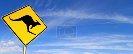 Photo for Kangaroo Warning Sign with panoramic blue sky behind. - Royalty Free Image