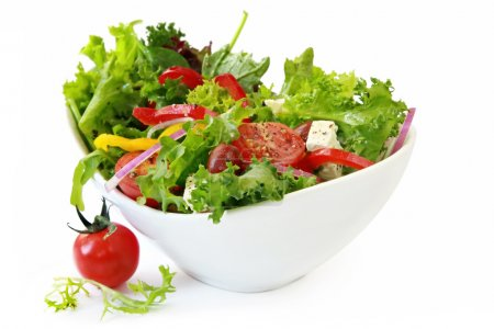 Photo for Healthy garden salad in stylish white bowl, isolated on white. - Royalty Free Image