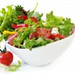 Healthy garden salad in stylish white bowl, isolat...