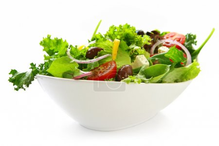 Photo for Healthy green salad, in stylish white bowl. Isolated on white. - Royalty Free Image