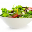 Healthy green salad, in stylish white bowl. Isolat...