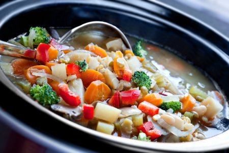 Photo for Vegetable soup, slow-cooked in a crock pot, ready to serve. - Royalty Free Image